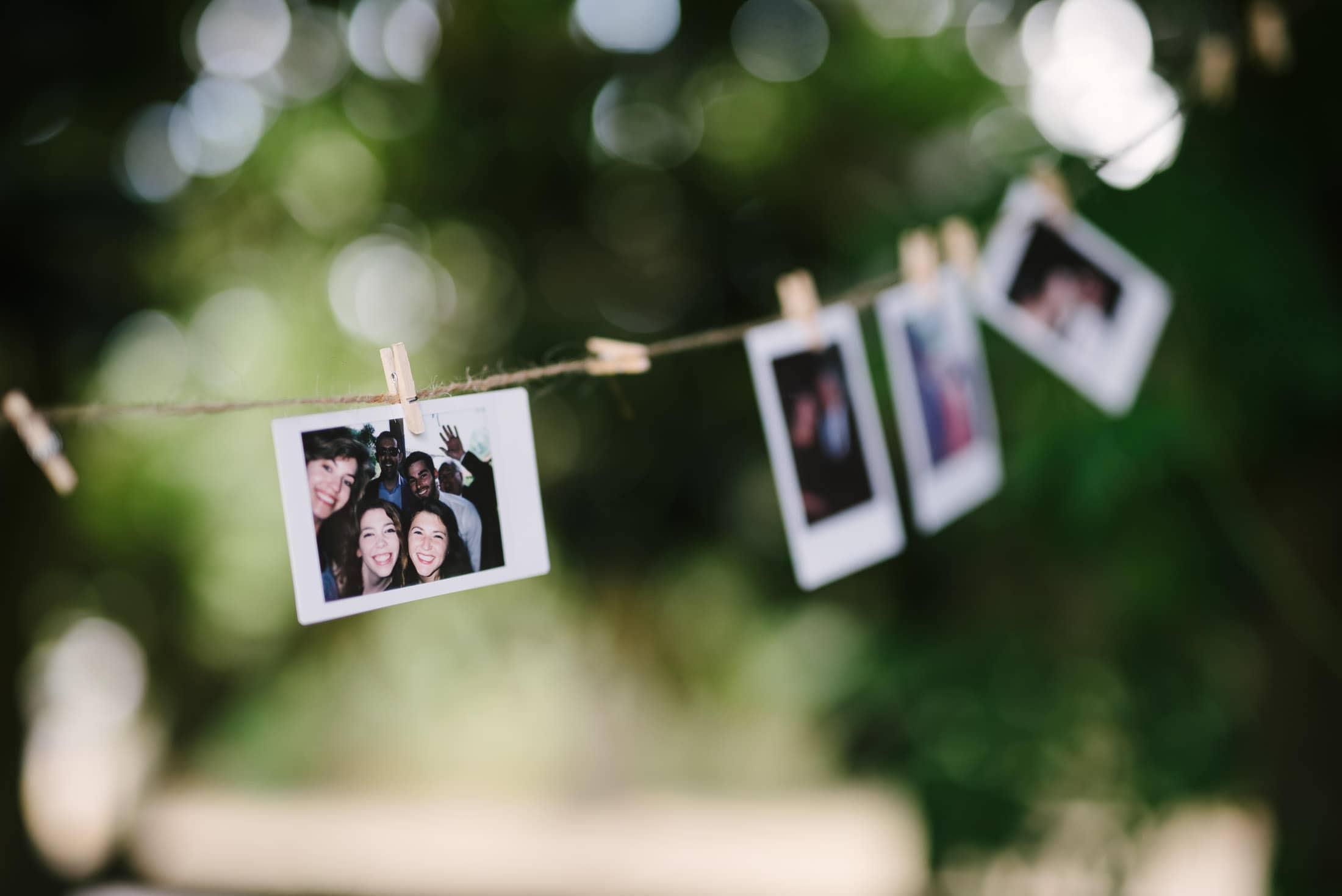 Polaroids hanging on line