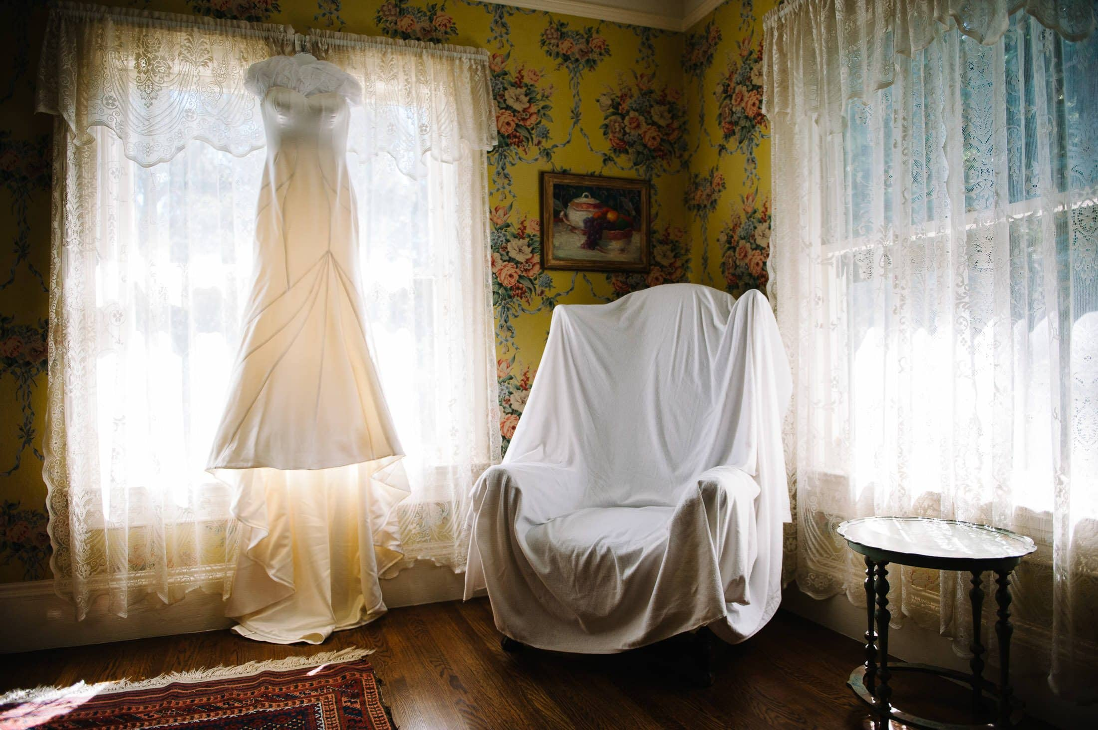 Fun, Artistic, and inspiring image of wedding dress against floral wall paper at Atherton Wedding