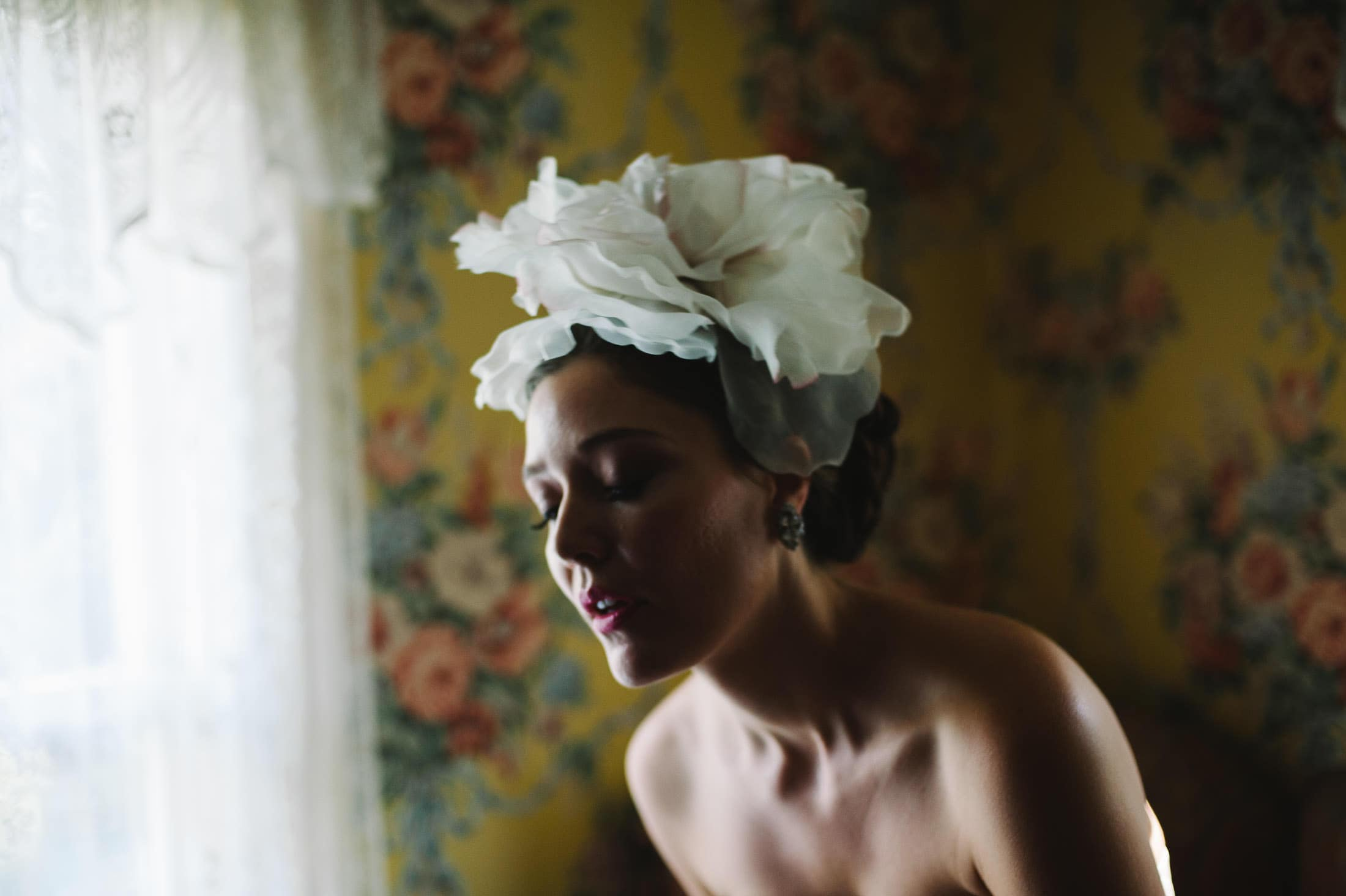 fun artistic shot of bride against floral wall paper at Atherton Wedding