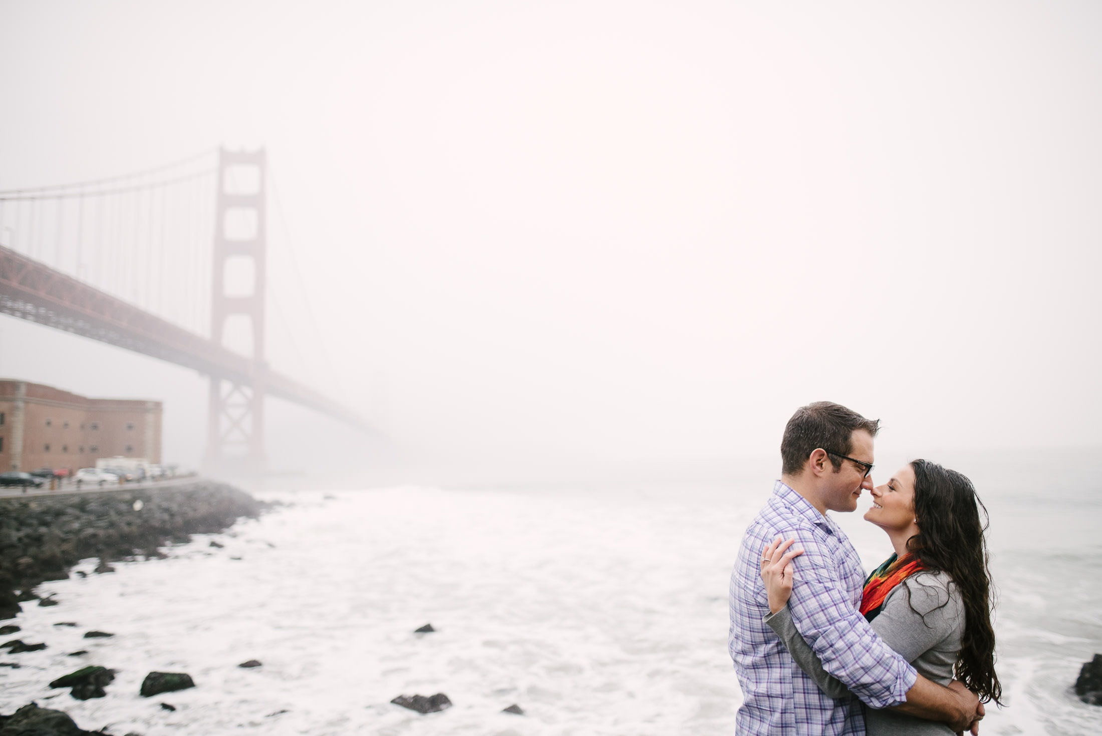 Engagement Session overlooking the golden gate bridge taken from fort point