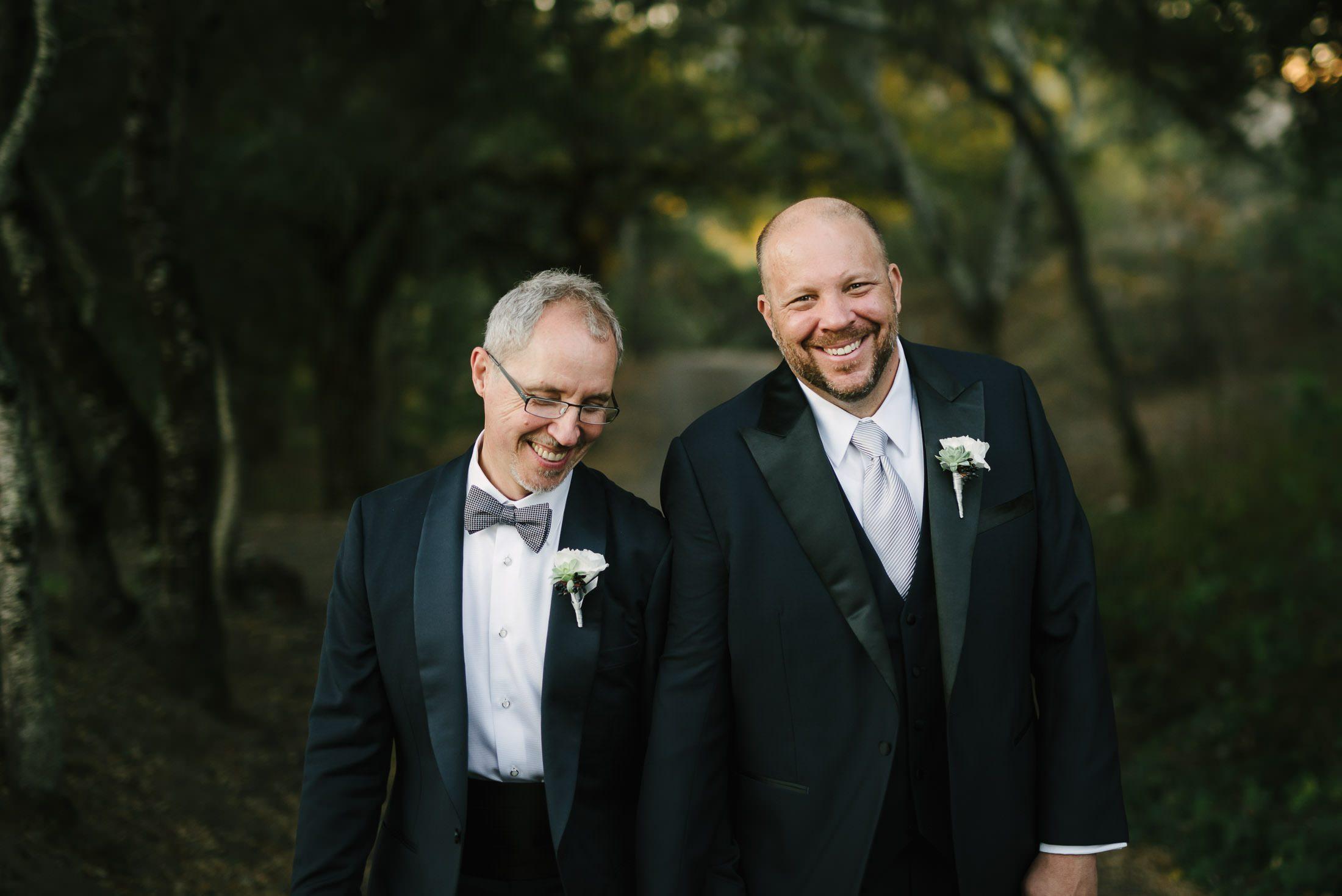 Gay Couple Laughing at Wedding