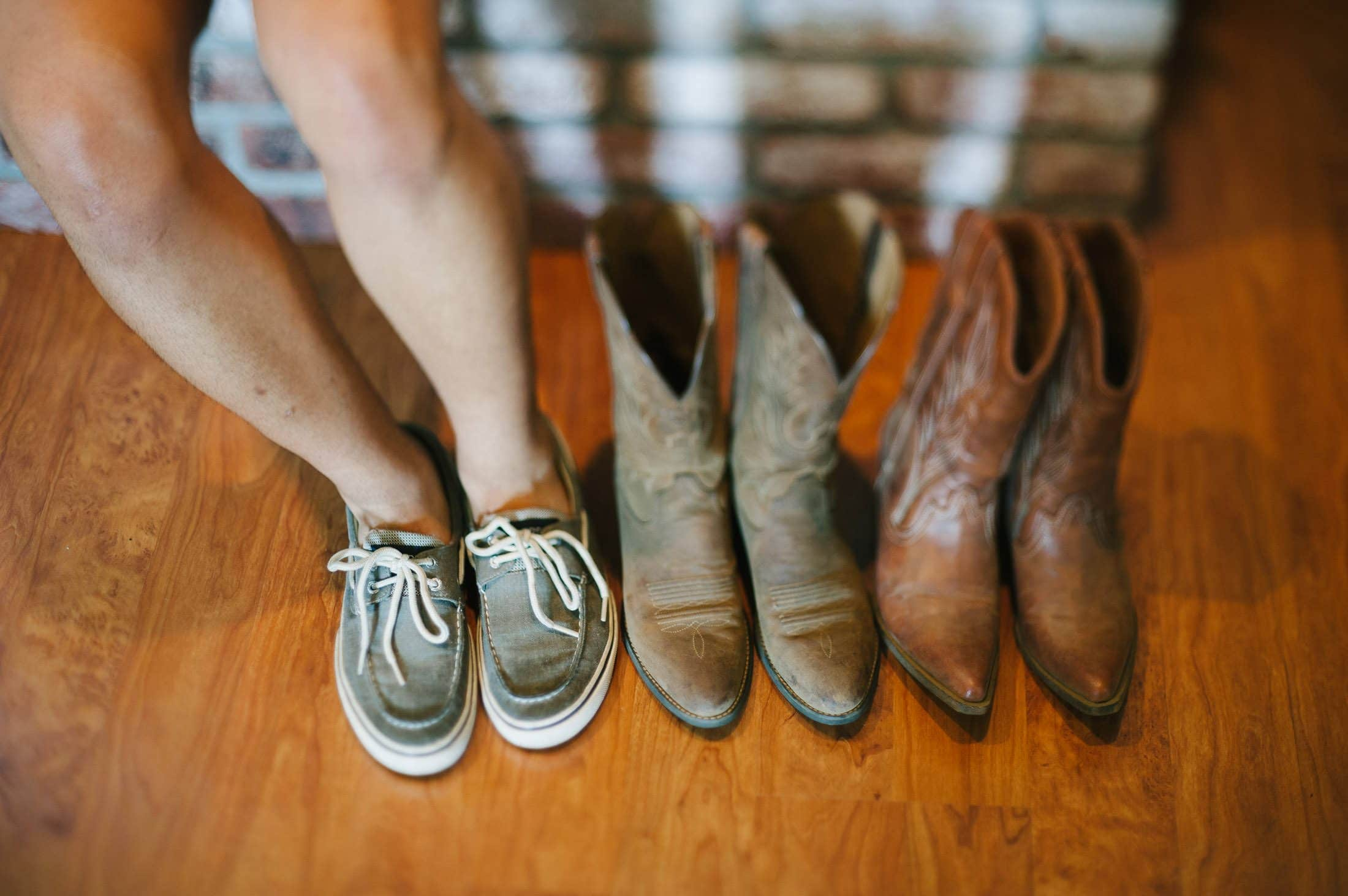Artistic wedding detail of shoes and boots