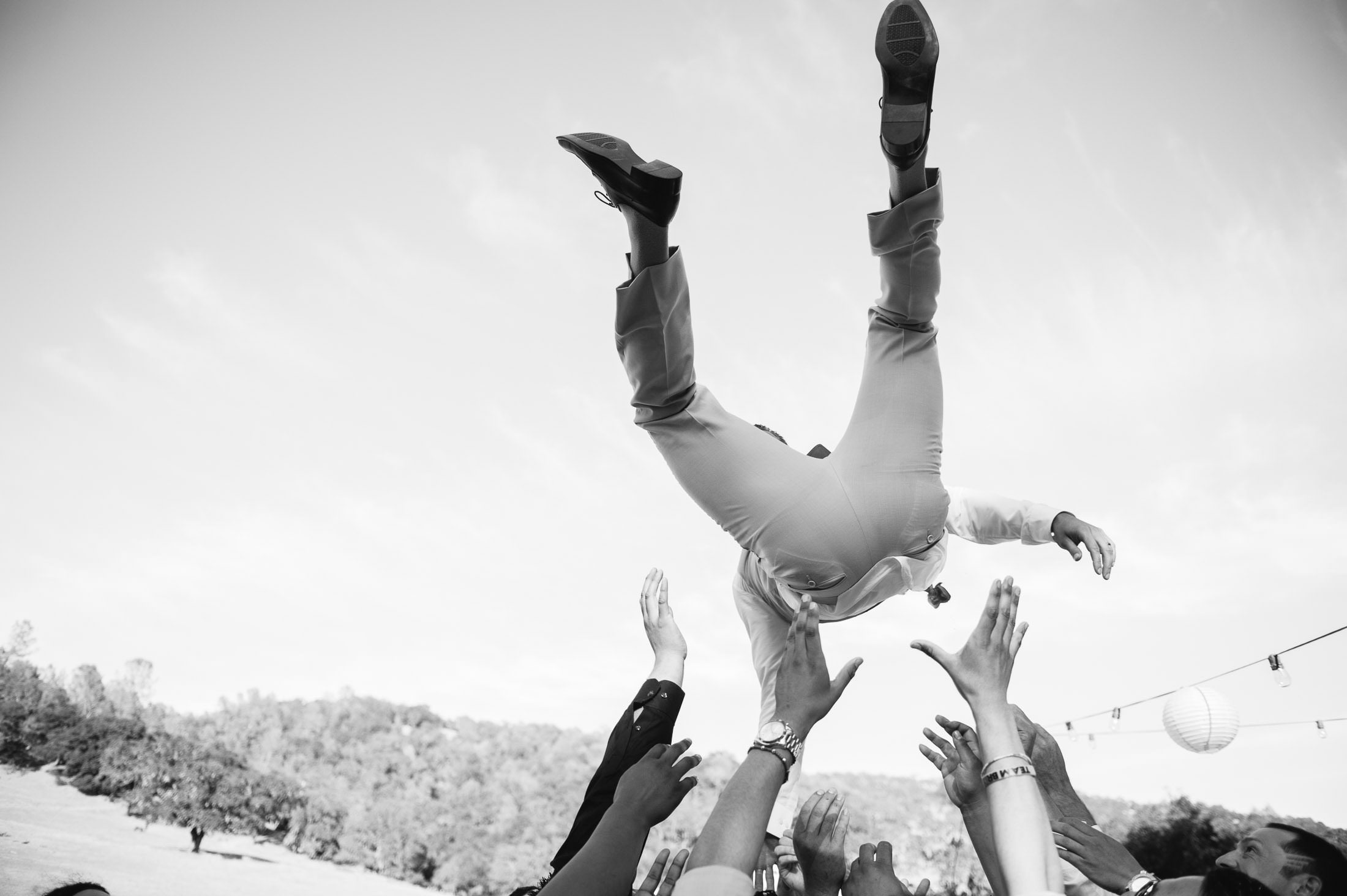 fun napa ranch wedding with groom tossed in the air