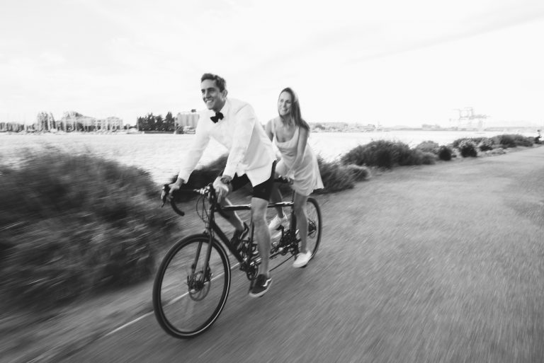 oakland couple on tandem bike at jack london square engagement