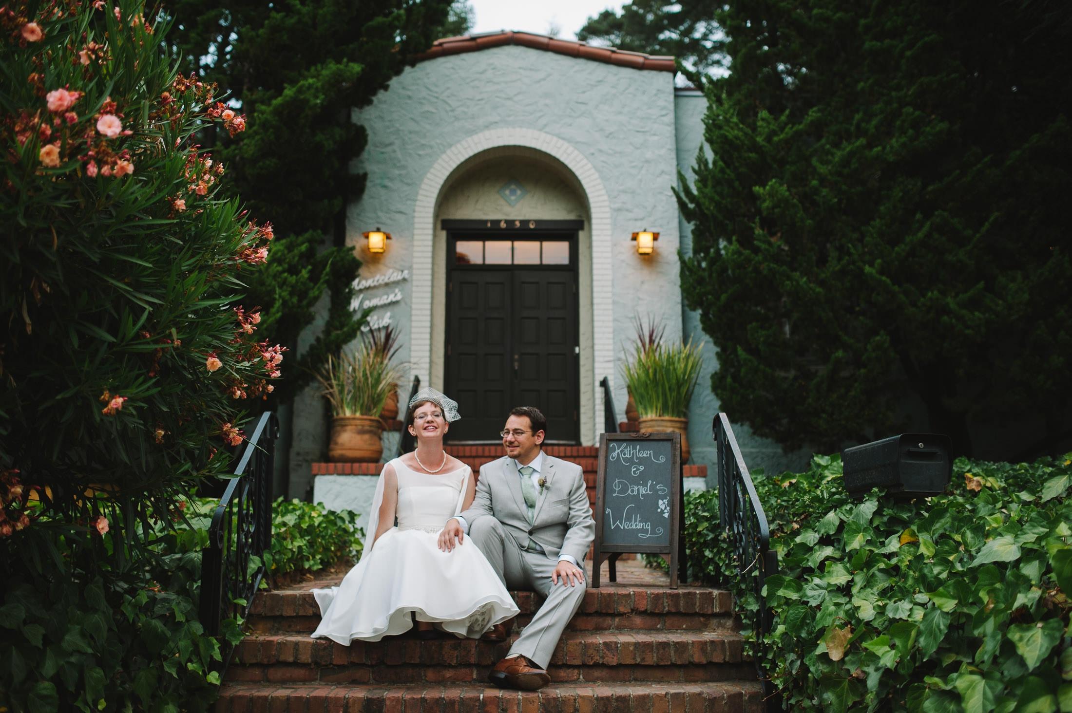 Fun Oakland Wedding couple on brick steps