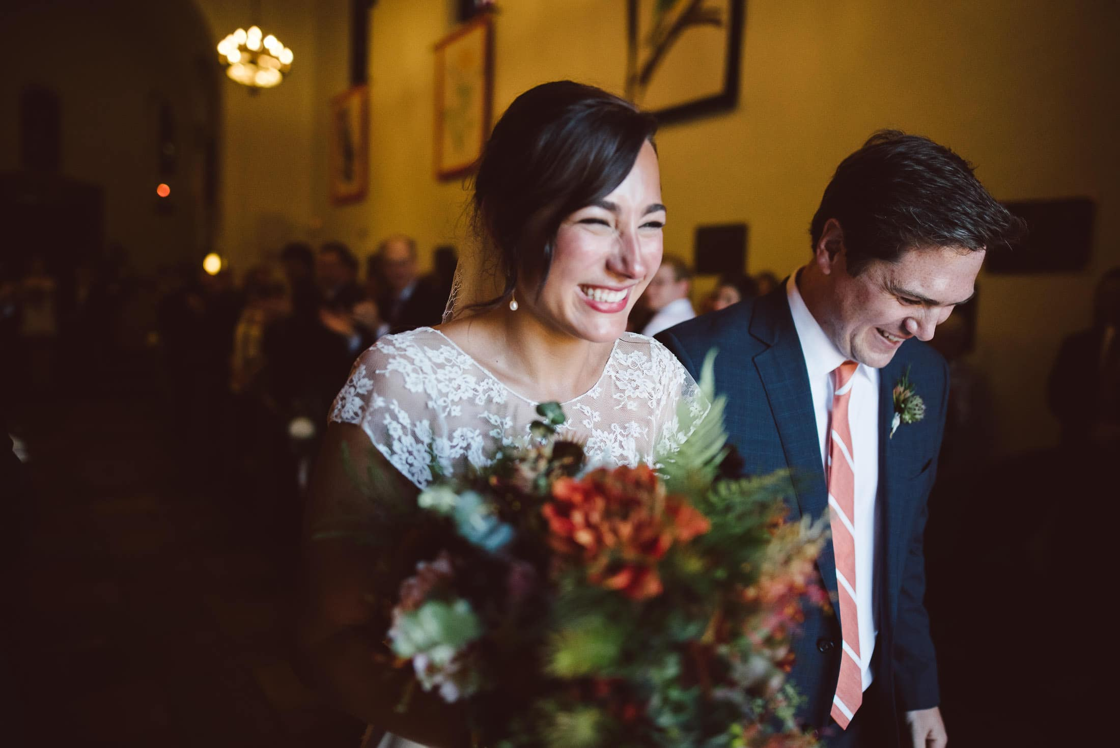Couple leaving Presidio Chapel after wedding