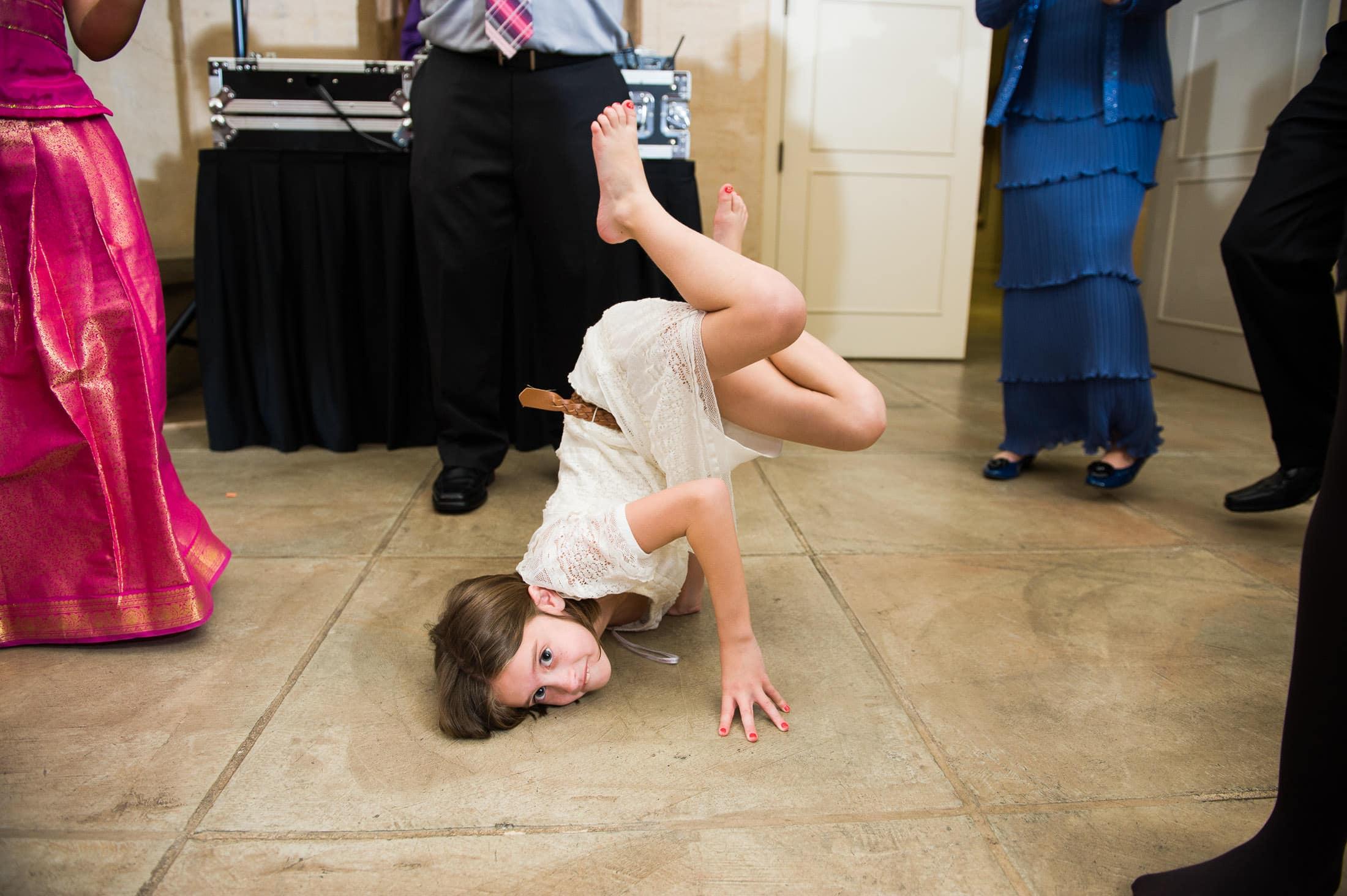 Fun kid dancing at Ramekins Culinary School Wedding