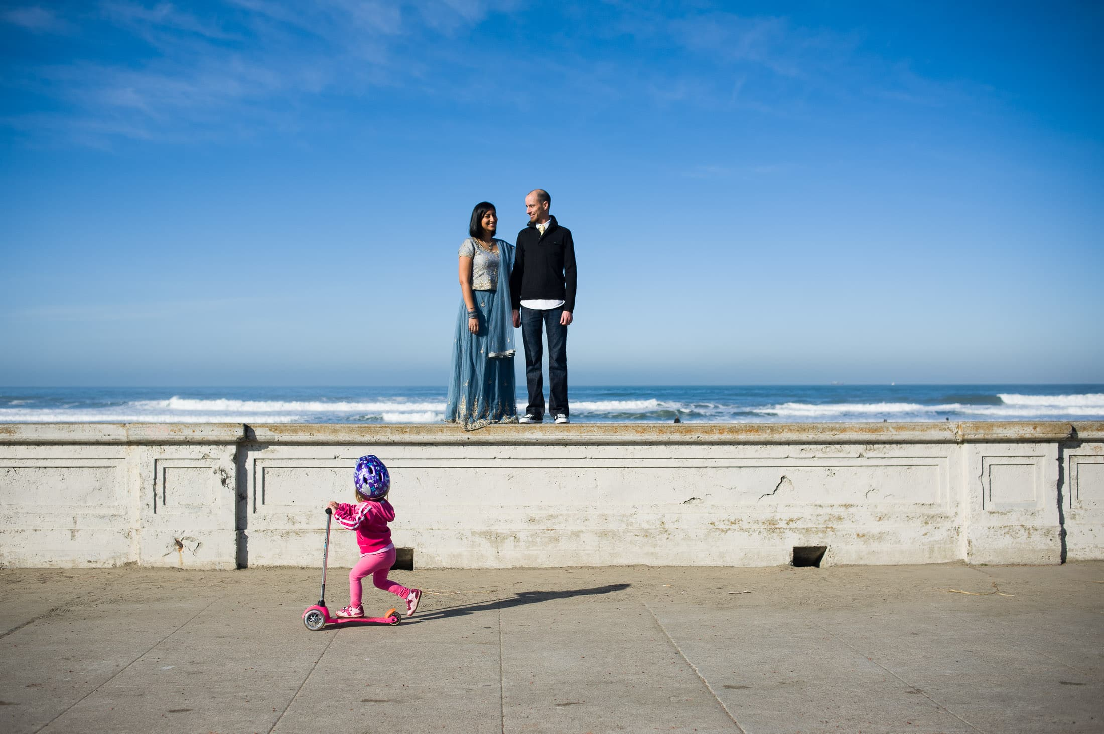 Fun San Francisco Ocean Beach Engagement with kid walking in front