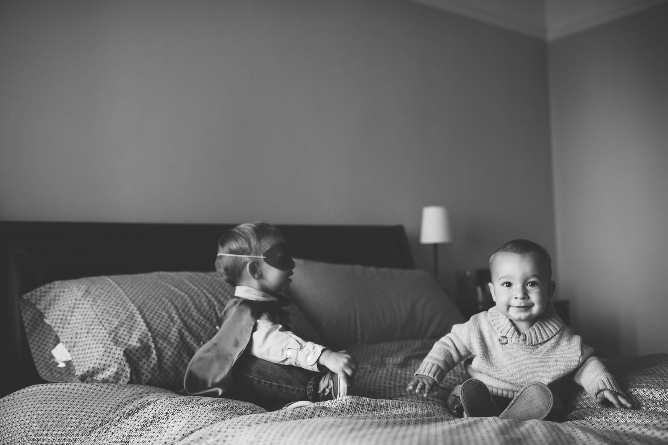 kids on bed with masks at san francisco family shoot