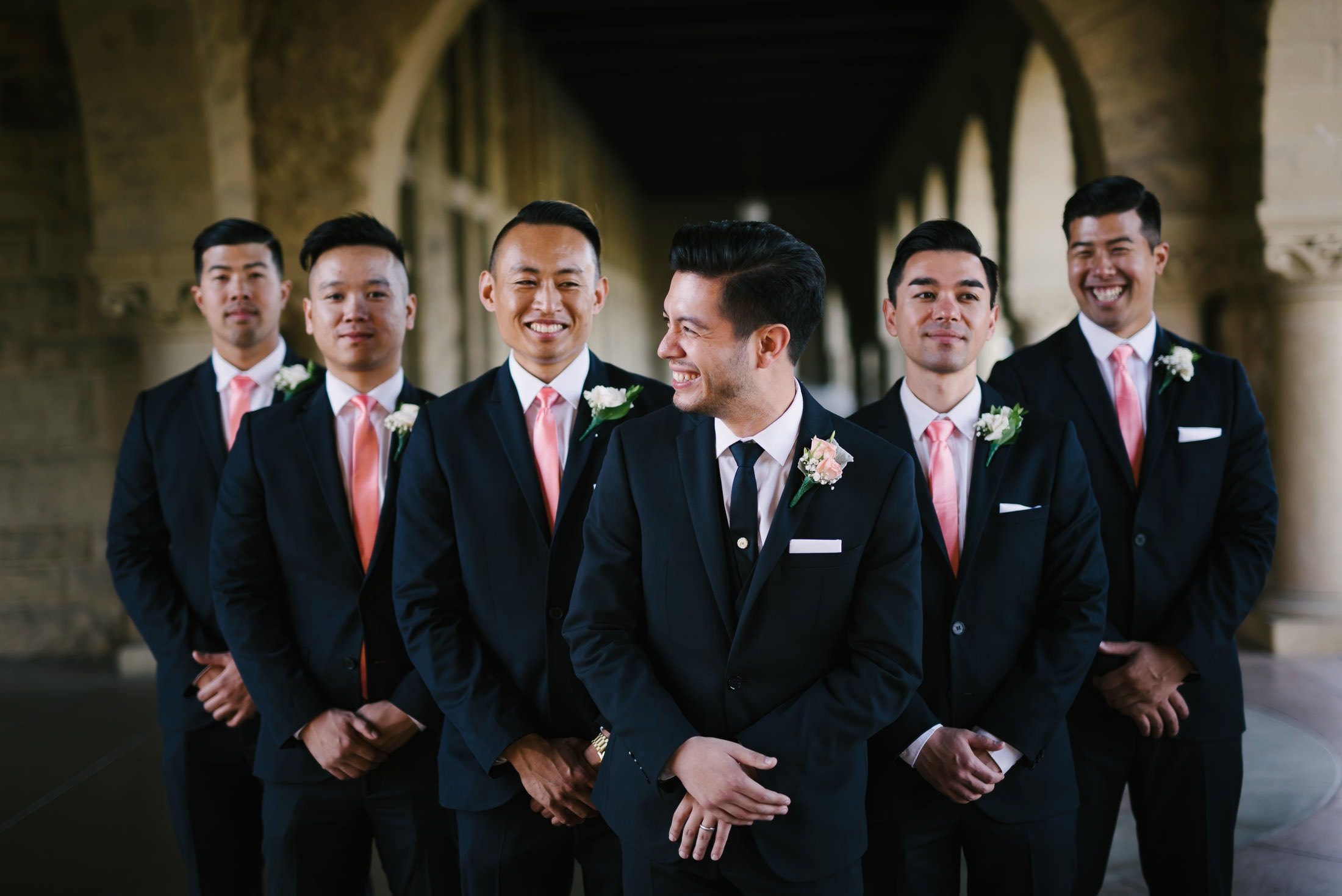 groom and groomsmen having fun at stanford wedding