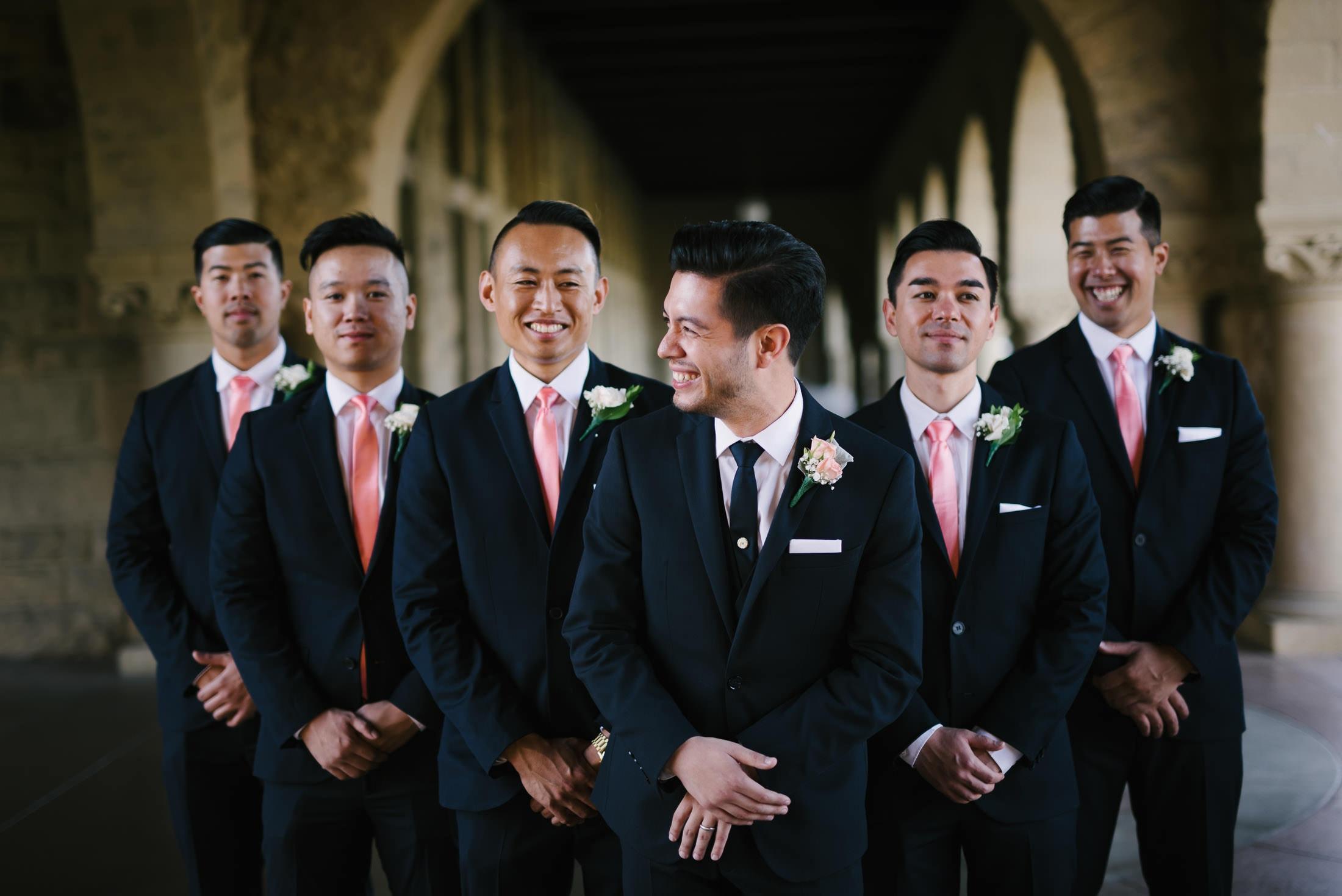 groom and groomsmen having fun at stanford wedding