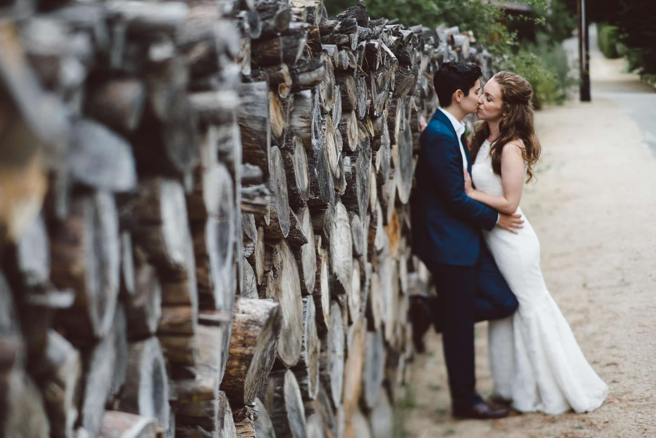 same sex couple kissing at the holly farm wedding