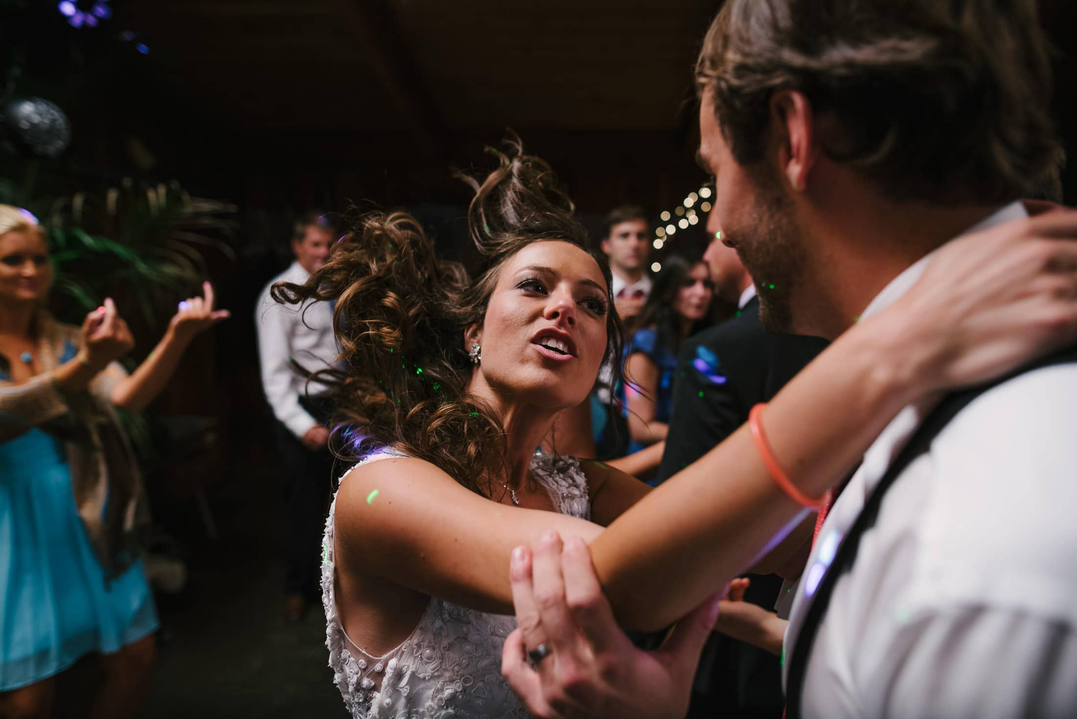people dancing at the holly farm wedding