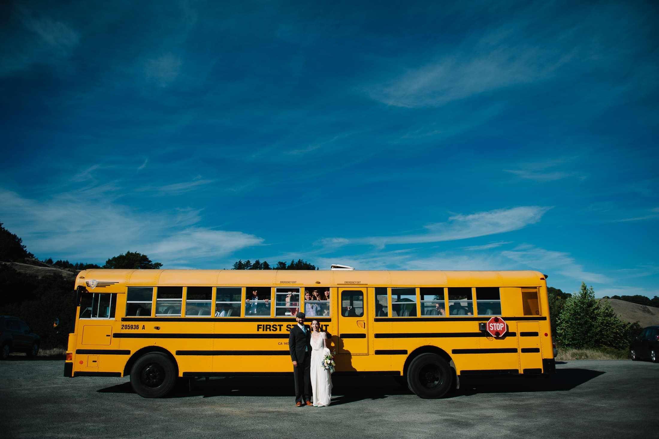 Trojan Point Wedding Ceremony with yellow school bus