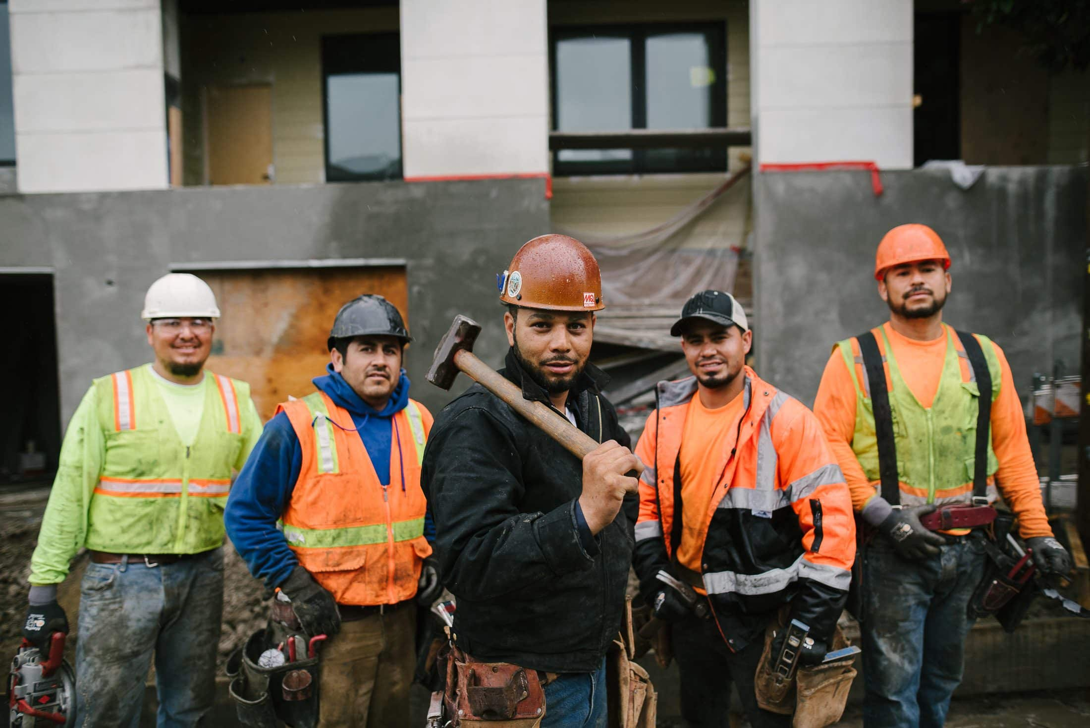 Construction workers outside of a wedding