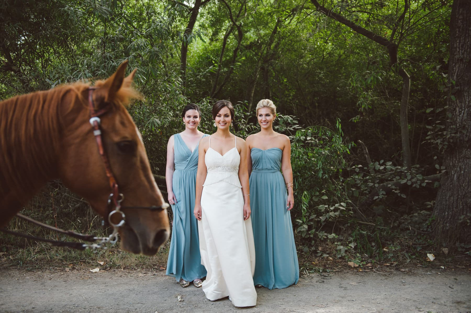 Pelican Inn Bridal Portrait with horse walking in front