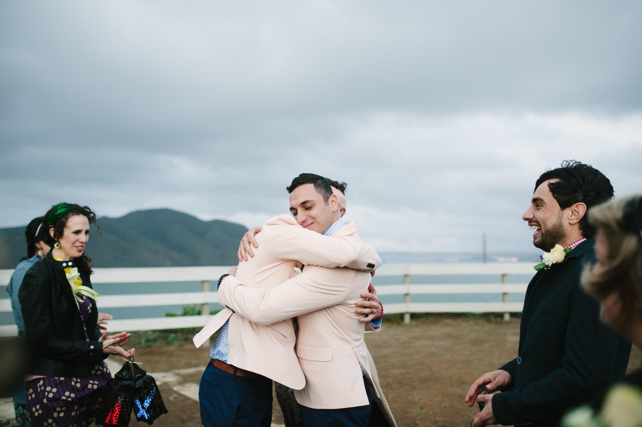 Same Sex Wedding Couple Hugging at Point Bonita Lighthouse